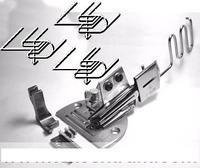 Zakladač A10K (K10) šíře vstupní pásky 34mm nastavitelný