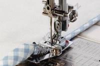 Patka pro lemování textilní páskou pro stroje s rotačním chapačem